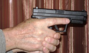 Both hands gripping a semi-automatic (trigger finger view)