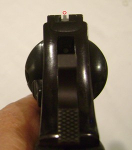 Front and rear sights properly aligned on a target (the red circle)