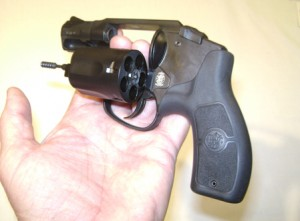 Opening the cylinder of a revolver using the shooting hand